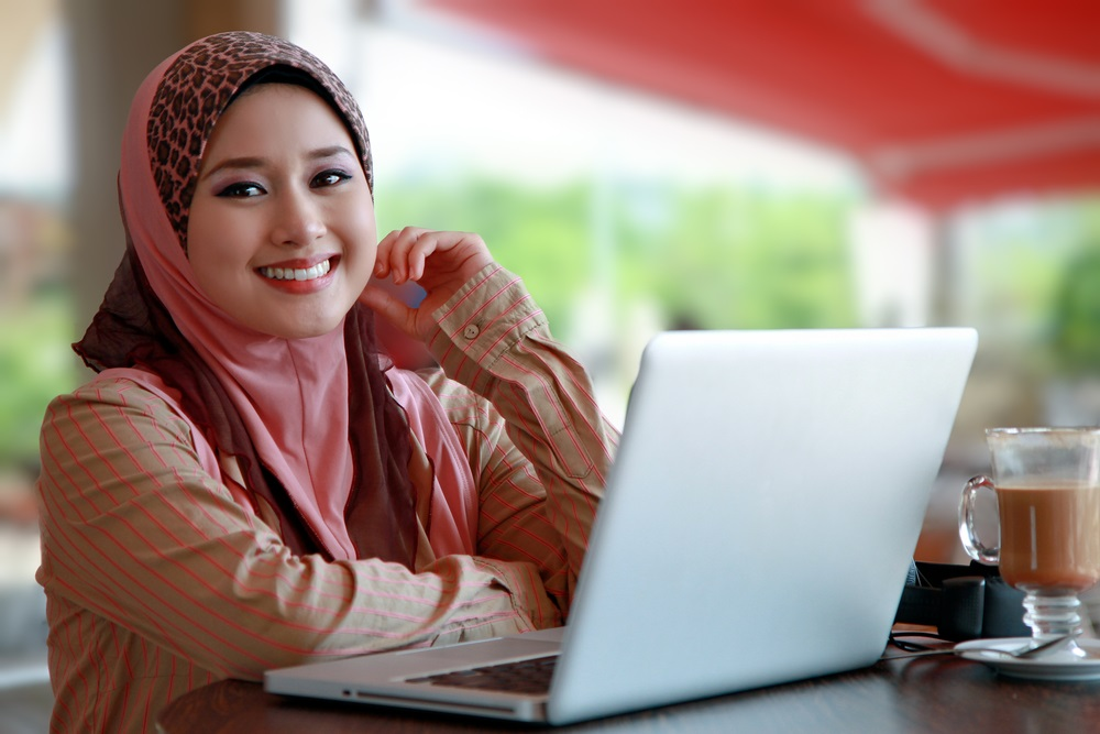 young muslim girl with tech