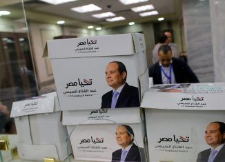 Members of the presidential campaign of Egypt's President Abdel Fattah al-Sisi count boxes containing his new presidential candidacy papers at the National Election Authority, which is in charge of supervising the 2018 presidential election in Cairo