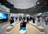 Visitors are seen at the Saudi Aramco stand at the Middle East Process Engineering Conference & Exhibition in Manama