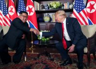 U.S. President Donald Trump shakes hands with North Korea's leader Kim Jong Un at the Capella Hotel in Singapore