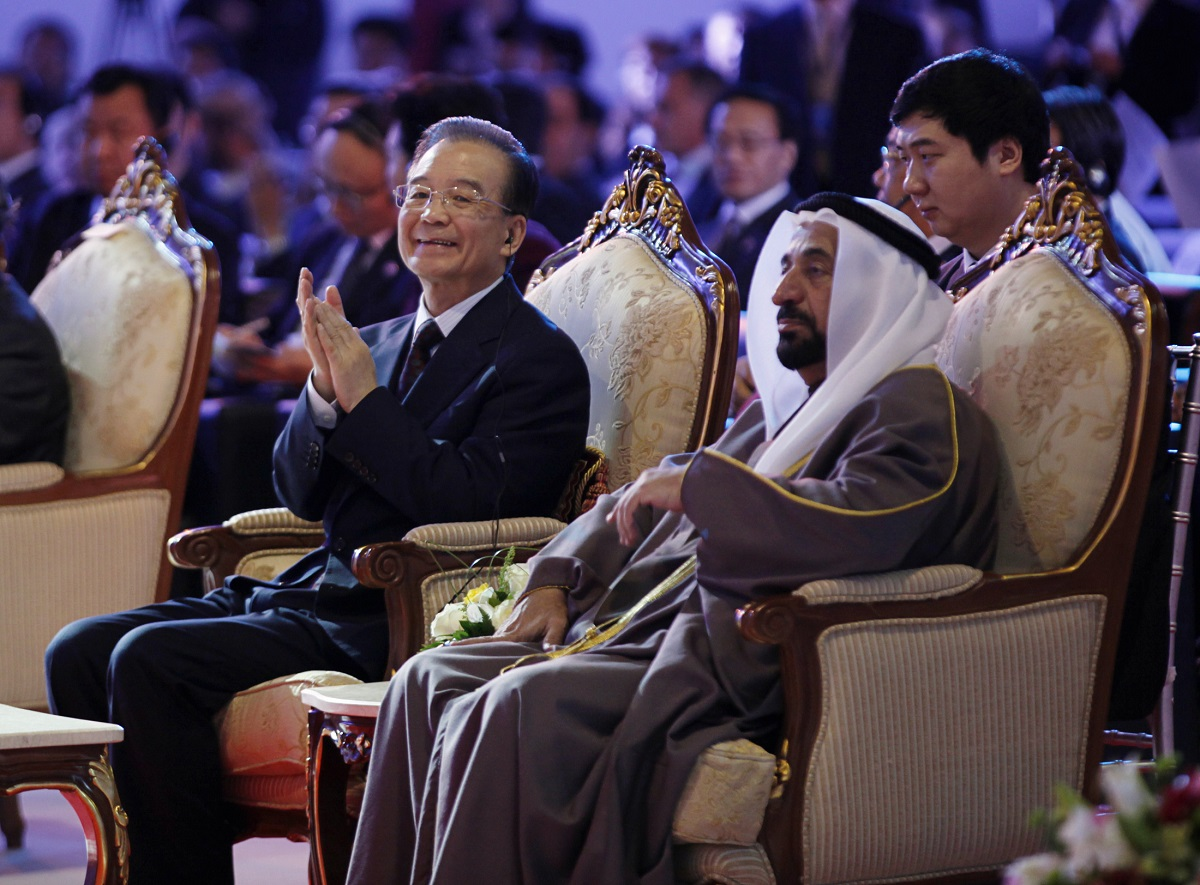 China's Premier Wen Jiabao sits with Ruler of Sharjah Sheikh Sultan during 4th China-Arab Business Conference in Sharjah