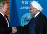 Russian President Vladimir Putin meets with Iranian President Hassan Rouhani on the sidelines of the SCO Summit in Qingdao