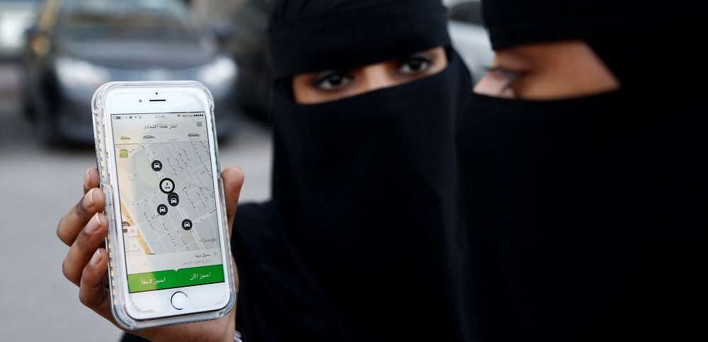 Saudi woman shows the Careem app on her mobile phone in Riyadh